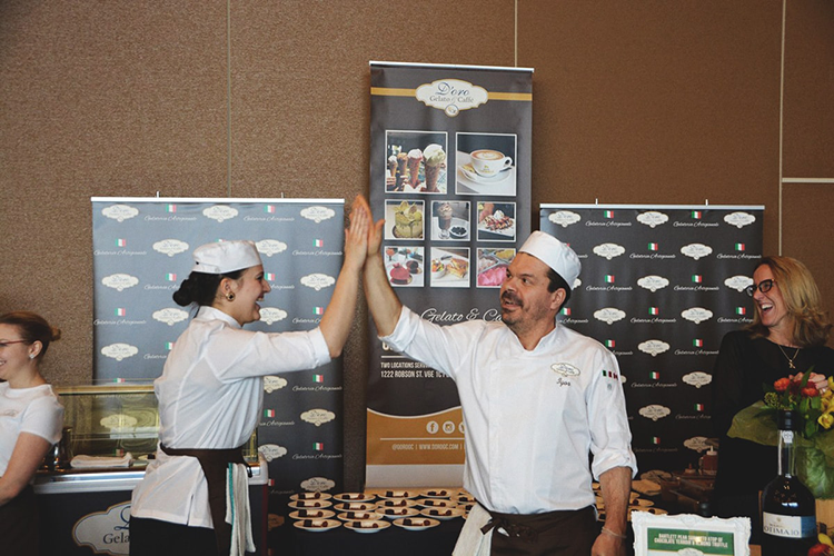 chefs high fiving at gelato booth
