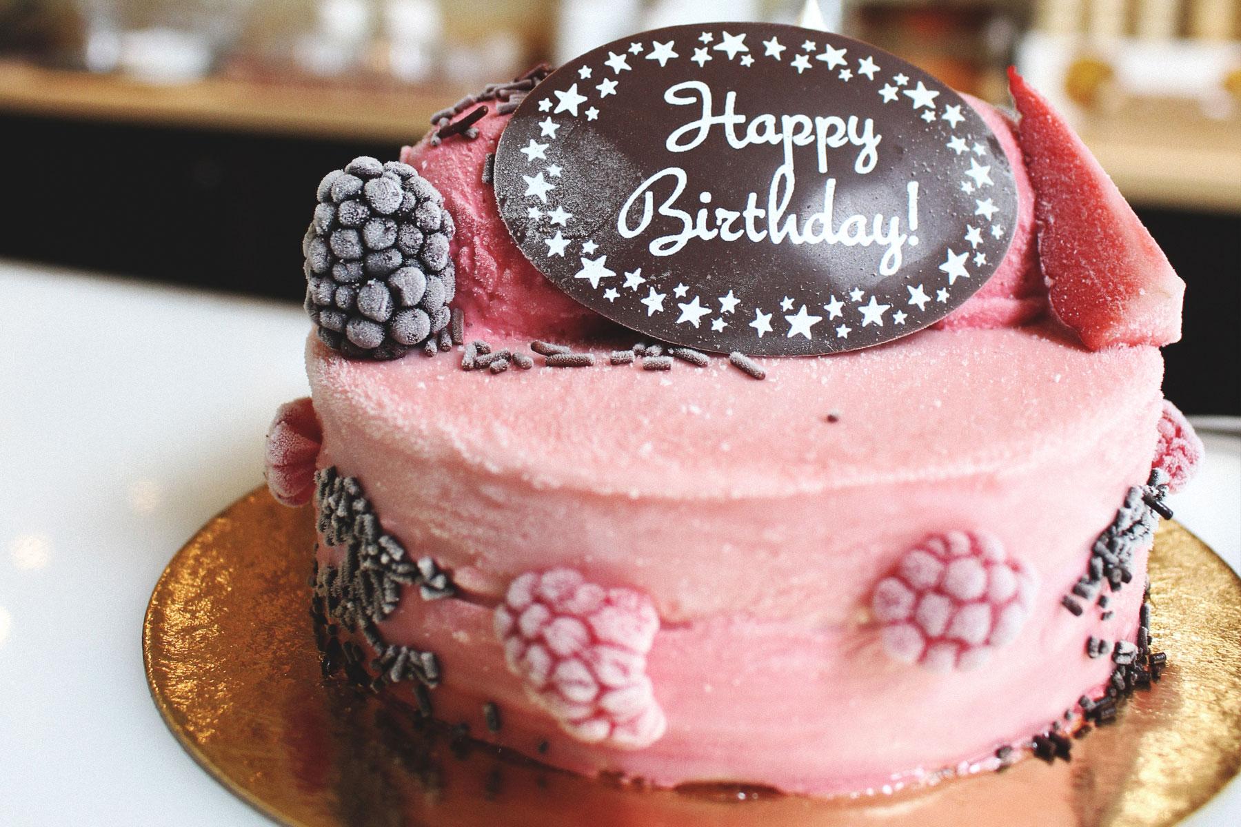 berry cake with happy birthday plaque